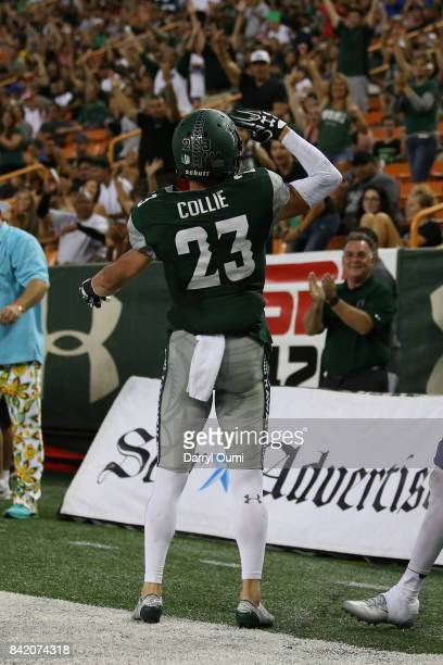 Dylan Collie of the Hawaii Rainbow Warriors salutes the crowd after scoring a touchdown in the first quarter of the game against the Western Carolina...