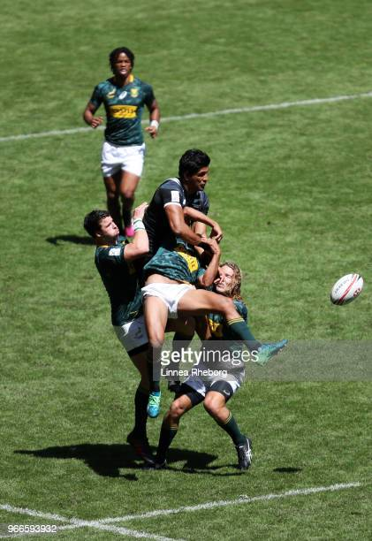 Dylan Collier of New Zealand Ruhan Nel of South Africa and Werner Kok of South Africa in action in their Cup Quarter Final match during the HSBC...