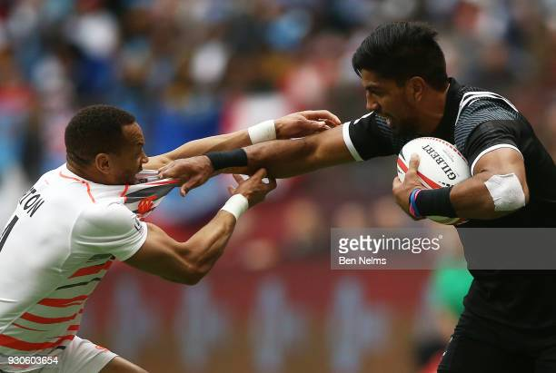 Dylan Collier of New Zealand runs the ball against Dan Norton of England during the Canada Sevens the Sixth round of the HSBC Sevens World Series at...