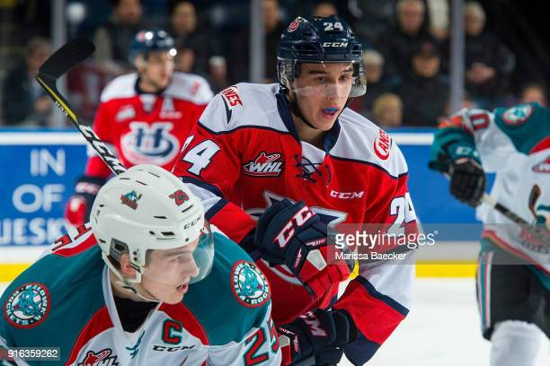 Dylan Cozens of the Lethbridge Hurricanes back checks Cal Foote of the Kelowna Rockets at Prospera Place on January 17 2018 in Kelowna Canada