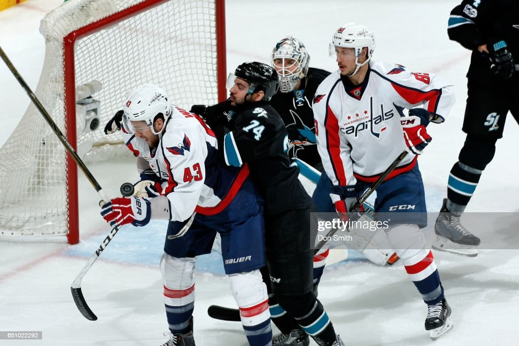 Dylan DeMelo #74 and Martin Jones #31of the San Jose Sharks defend against Tom Wilson #43 and Jay Beagle #83 of the Washington Capitals during a NHL game at SAP Center at San Jose on March 9, 2017 in San Jose, California.