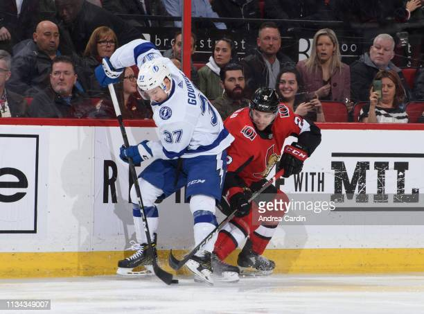 Dylan DeMelo of the Ottawa Senators battles for a puck with Yanni Gourde of the Tampa Bay Lightning at Canadian Tire Centre on April 1 2019 in Ottawa...