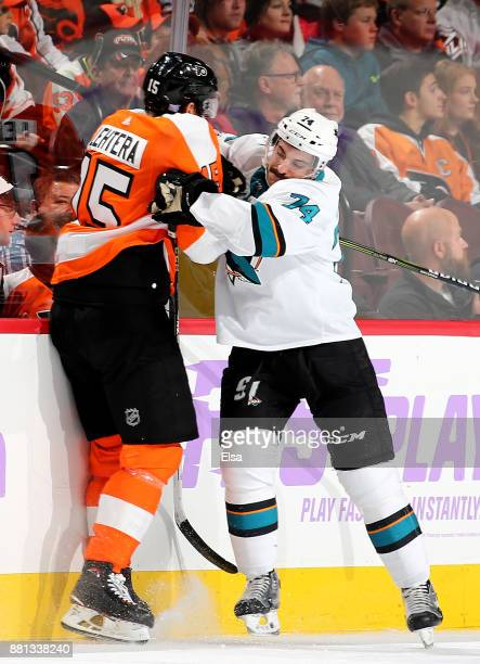 Dylan DeMelo of the San Jose Sharks and Jori Lehtera of the Philadelphia Flyers collide in the second period on November 28 2017 at Wells Fargo...