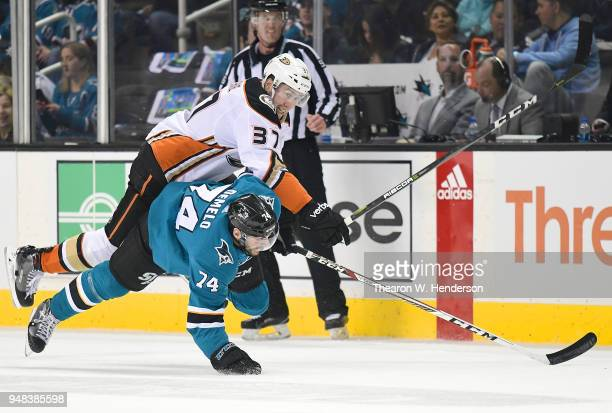 Dylan DeMelo of the San Jose Sharks and Nick Ritchie of the Anaheim Ducks collide during the first period in Game Four of the Western Conference...