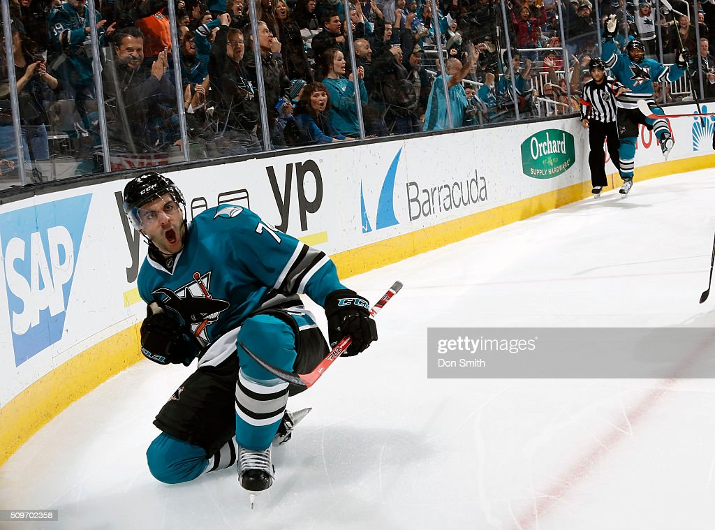 Dylan DeMelo #74 of the San Jose Sharks celebrates after a goal against the Calgary Flames during a NHL game at the SAP Center at San Jose on February 11, 2016 in San Jose, California.