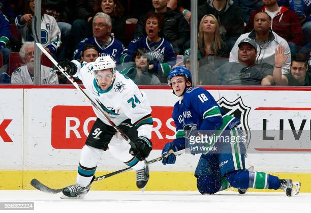 Dylan DeMelo of the San Jose Sharks chef kid Jake Virtanen of the Vancouver Canucks during their NHL game at Rogers Arena March 17 2018 in Vancouver...