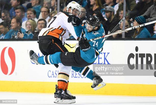 Dylan DeMelo of the San Jose Sharks is checked to the ice by Nick Ritchie of the Anaheim Ducks during the first period in Game Four of the Western...