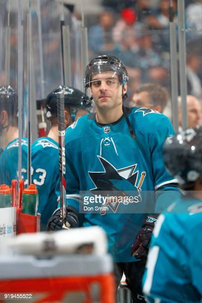 Dylan DeMelo of the San Jose Sharks looks from the bench during a NHL game against the Arizona Coyotes at SAP Center on February 13 2018 in San Jose...