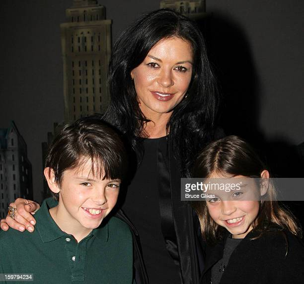 Dylan Douglas Catherine Zeta Jones and Carys Douglas pose backstage at the hit musical Annie on Broadway at The Palace Theater on January 20 2013 in...