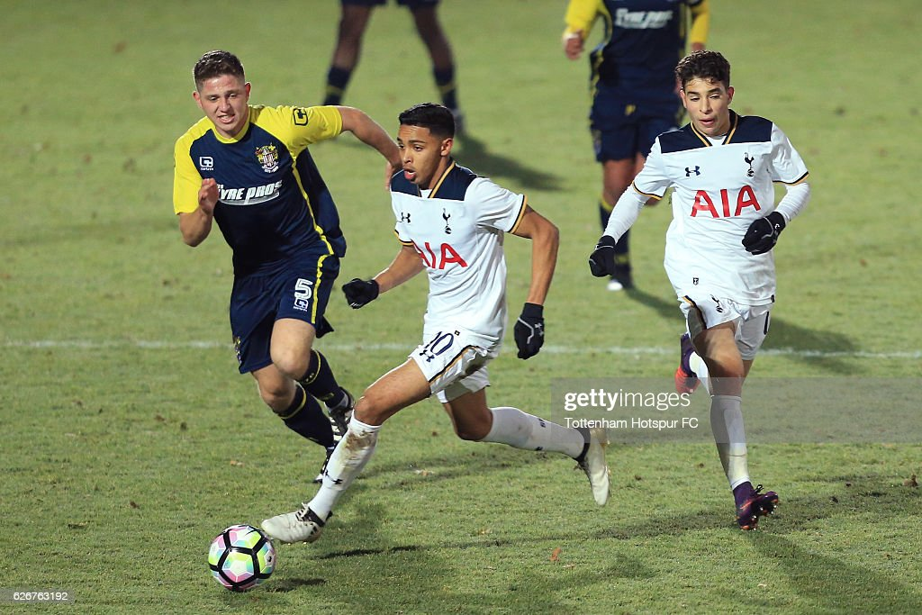 Dylan Duncan of Tottenham Hotspur holds off pressure from Charley O'Keefe of Stevenage during the FA Youth Cup Third Round between Tottenham Hotspur and Stevenage at The Lamex Stadium on November 30, 2016 in Stevenage, England.