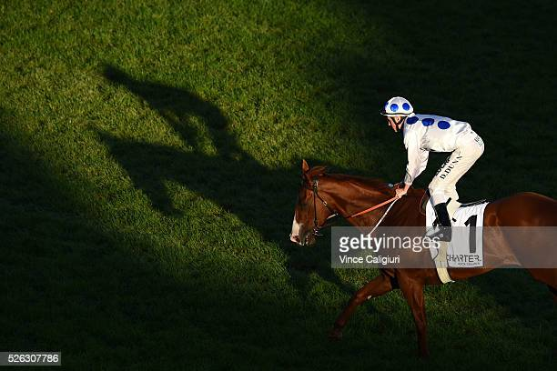 Dylan Dunn riding Charmed Harmony after winning Race 8 during Melbourne Racing at Caulfield Racecourse on April 30 2016 in Melbourne Australia