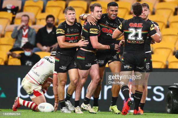 Dylan Edwards and the Panthers celebrate a try during the round 22 NRL match between the St George Illawarra Dragons and the Penrith Panthers at...