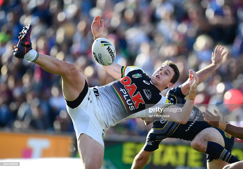 Dylan Edwards of the Panthers and Lachlan Coote of the Cowboys contest a high ball during the round 16 NRL match between the North Queensland Cowboys and the Penrith Panthers at 1300SMILES Stadium on June 24, 2017 in Townsville, Australia.
