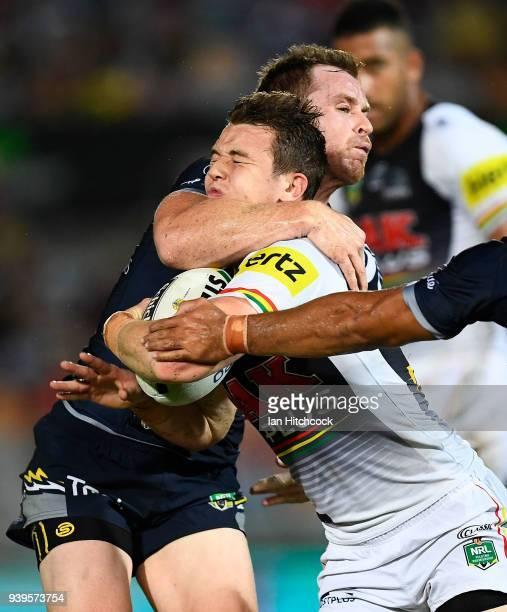 Dylan Edwards of the Panthers is tackled by Michael Morgan of the Cowboys during the round four NRL match between the North Queensland Cowboys and...