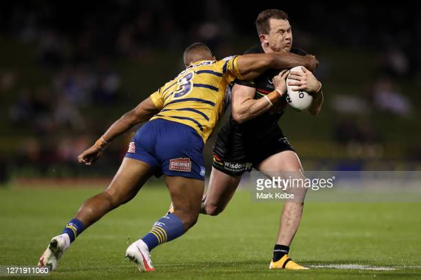 Dylan Edwards of the Panthers is tackled during the round 18 NRL match between the Penrith Panthers and the Parramatta Eels at Panthers Stadium on...