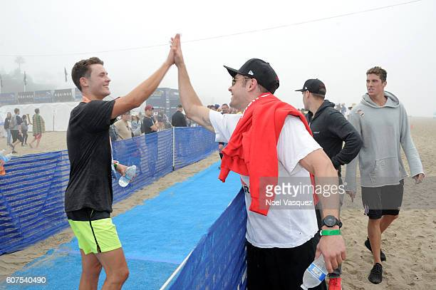 Dylan Efron is congratulated by his borther Zach Efron and olympic gold medalist Conor Dwyer after participating in the Nautica Malibu Traithalon...