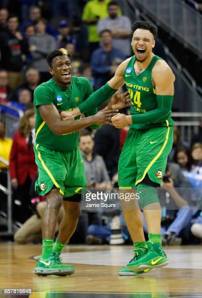 Dylan Ennis and Dillon Brooks of the Oregon Ducks react in the second half against the Kansas Jayhawks during the 2017 NCAA Men's Basketball...