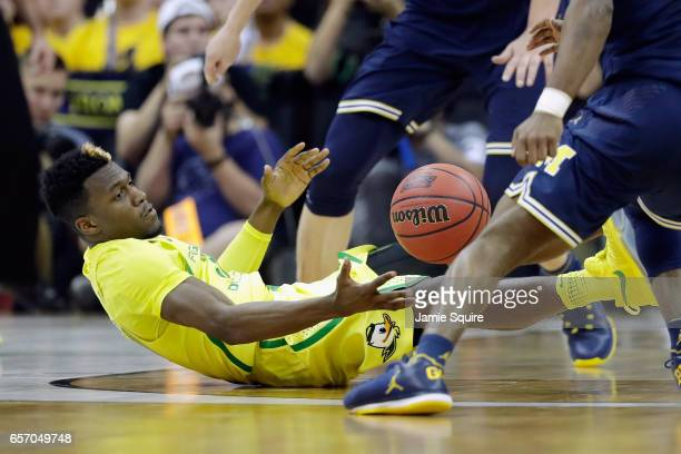 Dylan Ennis of the Oregon Ducks battles for a loose ball in the first half against the Michigan Wolverines during the 2017 NCAA Men's Basketball...