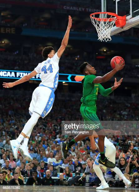 Dylan Ennis of the Oregon Ducks drives to the basket against Justin Jackson of the North Carolina Tar Heels in the second half during the 2017 NCAA...