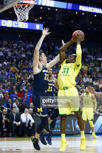 Dylan Ennis of the Oregon Ducks elevates for a shot contested by Duncan Robinson of the Michigan Wolverines during the 2017 NCAA Photos via Getty...