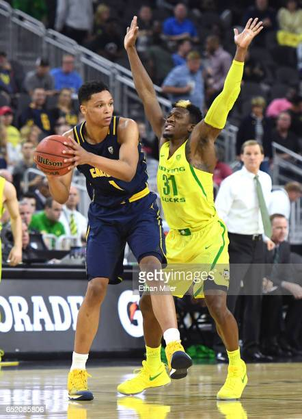 Dylan Ennis of the Oregon Ducks guards Ivan Rabb of the California Golden Bears during a semifinal game of the Pac12 Basketball Tournament at TMobile...