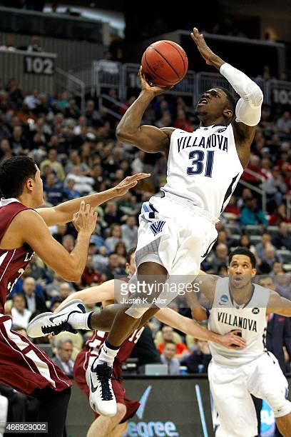 Dylan Ennis of the Villanova Wildcats rebounds the ball against the Lafayette Leopards in the second half during the second round of the 2015 NCAA...