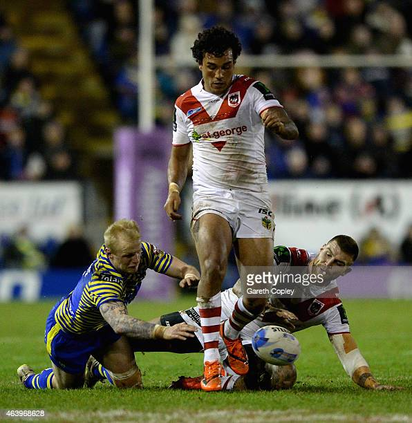 Dylan Farrell of St George Illawarra Dragons kicks the ball ahead during the World Club Series match between Warrington Wolves and St George...