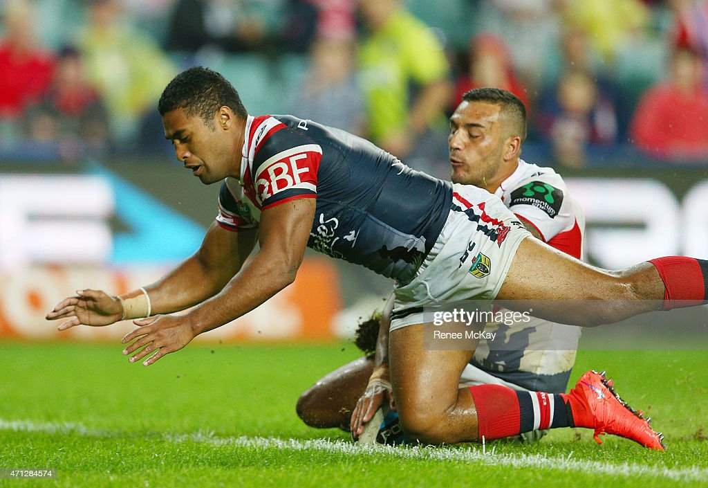 Dylan Farrell of the Dragons scores a try that was disallowed as Michael Jennings attempts to defend during the round eight NRL match between the Sydney Roosters and the St George Illawarra Dragons at Allianz Stadium on April 25, 2015 in Sydney, Australia.