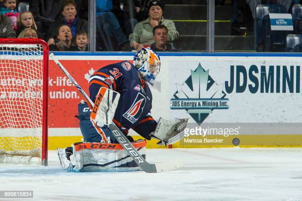 Dylan Ferguson of the Kamloops Blazers defends the net and makes a save against the Kelowna Rockets on December 27 2017 at Prospera Place in Kelowna...