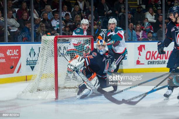 Dylan Ferguson of the Kamloops Blazers deflects a shot from Kole Lind of the Kelowna Rockets during third period on December 27 2017 at Prospera...