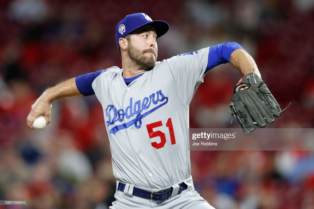 Dylan Floro #51 of the Los Angeles Dodgers pitches in the sixth inning of the game against the Cincinnati Reds at Great American Ball Park on September 11, 2018 in Cincinnati, Ohio. The Reds won 3-1.