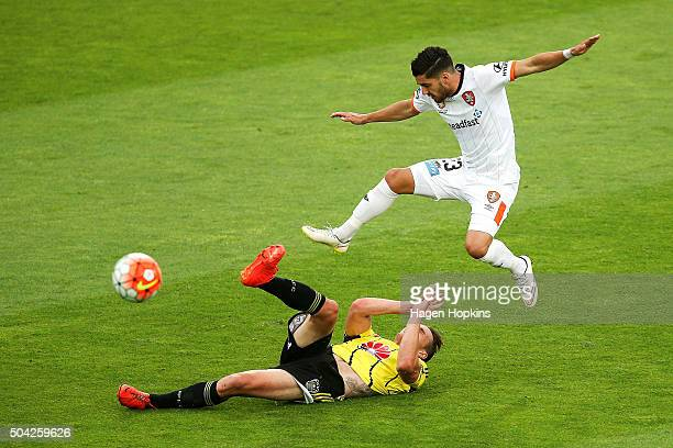 Dylan Fox of the Phoenix clears the ball under pressure from Dimitri Petratos of the Roar during the round 14 ALeague match between the Wellington...
