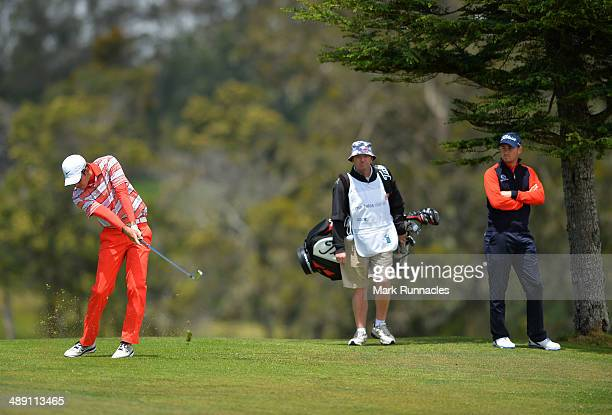 Dylan Frittelli of Republic of South Africa plays his approach shot to the 3rd green, watched by Daniel Brooks of England during the Madeira Islands...