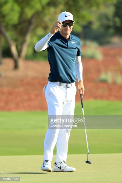 Dylan Frittelli of South Africa acknowledges the crowd on the 18th green during the third round of the DP World Tour Championship at Jumeirah Golf...