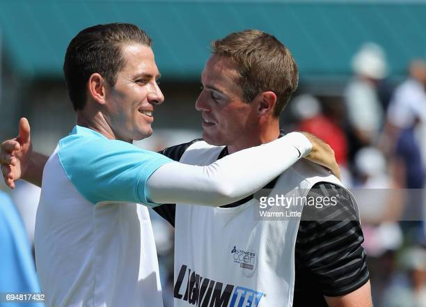 Dylan Frittelli of South Africa cleebrates with his caddie after winning the Lyoness Open at Diamond Country Club on June 11 2017 in Atzenbrugg...