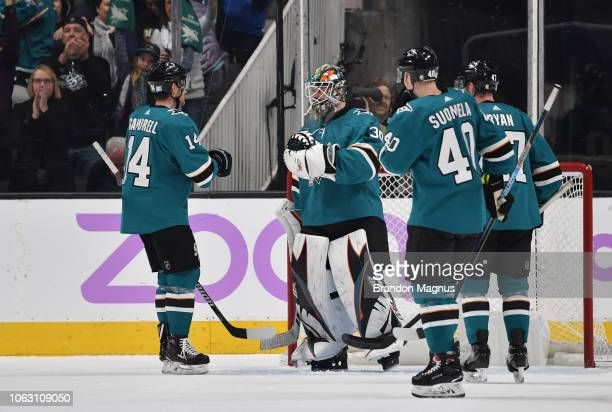 Dylan Gambrell Aaron Dell Antti Suomela and Joakim Ryan of the San Jose Sharks celebrate the win against the St Louis Blues at SAP Center on November...