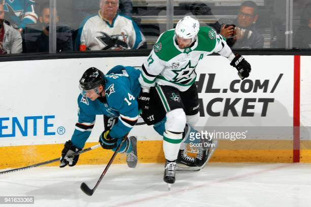 Dylan Gambrell of the San Jose Sharks and Alexander Radulov of the Dallas Stars get tangled up along the boards at SAP Center on April 3 2018 in San...