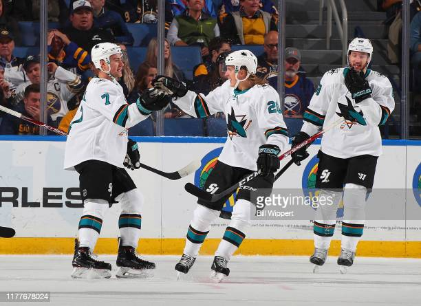 Dylan Gambrell of the San Jose Sharks celebrates after scoring his first NHL goal during a game against the Buffalo Sabres on October 22 2019 at...