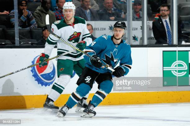 Dylan Gambrell of the San Jose Sharks skates against Charlie Coyle of the Minnesota Wild at SAP Center on April 7 2018 in San Jose California Dylan...