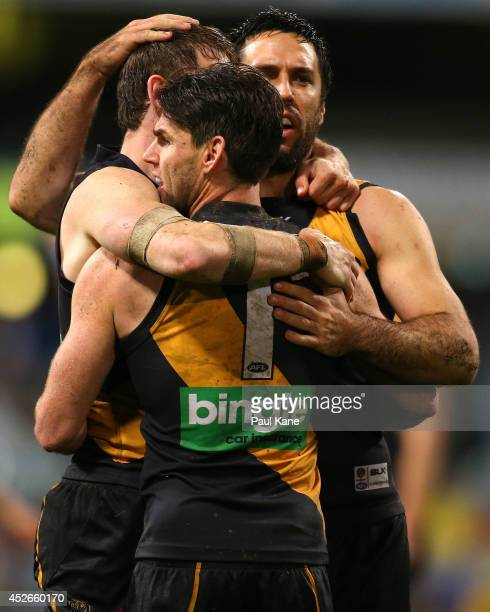 Dylan Grimes Chris Newman and Troy Chaplin of the Tigers celebrate winning the round 18 AFL match between the West Coast Eagles and the Richmond...