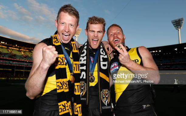 Dylan Grimes, David Astbury and Nick Vlastuin of the Tigers celebrate during the 2019 Toyota AFL Grand Final match between the Richmond Tigers and...