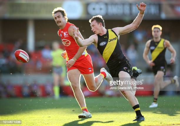 Dylan Grimes of Richmond chases the ball during the round 21 AFL match between the Gold Coast Suns and the Richmond Tigers at Metricon Stadium on...
