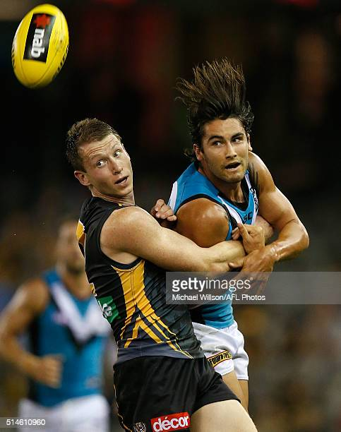 Dylan Grimes of the Tigers and Chad Wingard of the Power compete for the ball during the 2016 NAB Challenge match between the Richmond Tigers and...