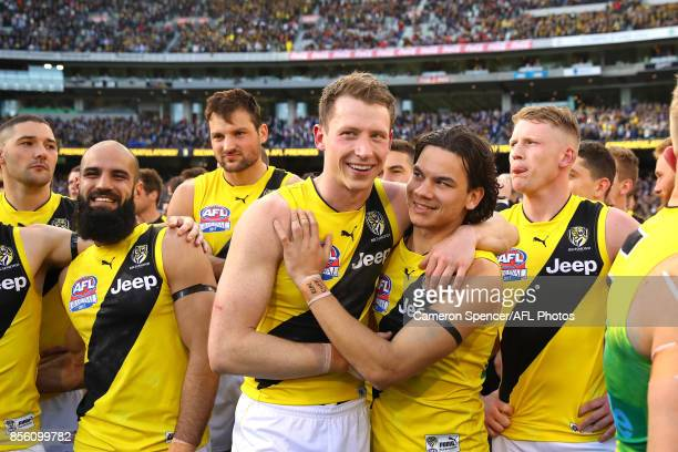 Dylan Grimes of the Tigers and Daniel Rioli of the Tigers embrace after winning the 2017 AFL Grand Final match between the Adelaide Crows and the...