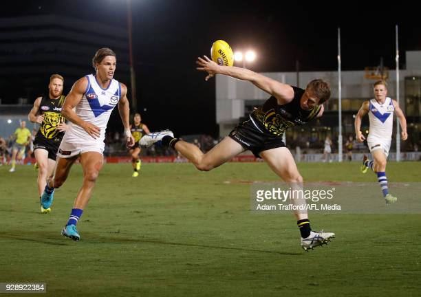 Dylan Grimes of the Tigers and Mason Wood of the Kangaroos compete for the ball during the AFL 2018 JLT Community Series match between the Richmond...