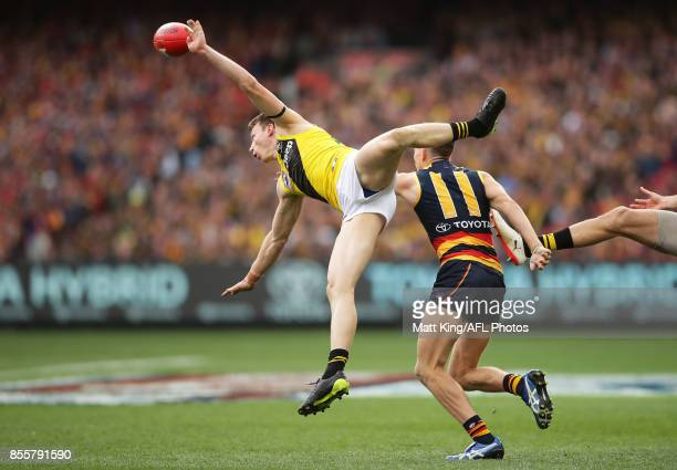 Dylan Grimes of the Tigers attempts a mark under pressure from Paul Seedsman of the Crows during the 2017 AFL Grand Final match between the Adelaide...