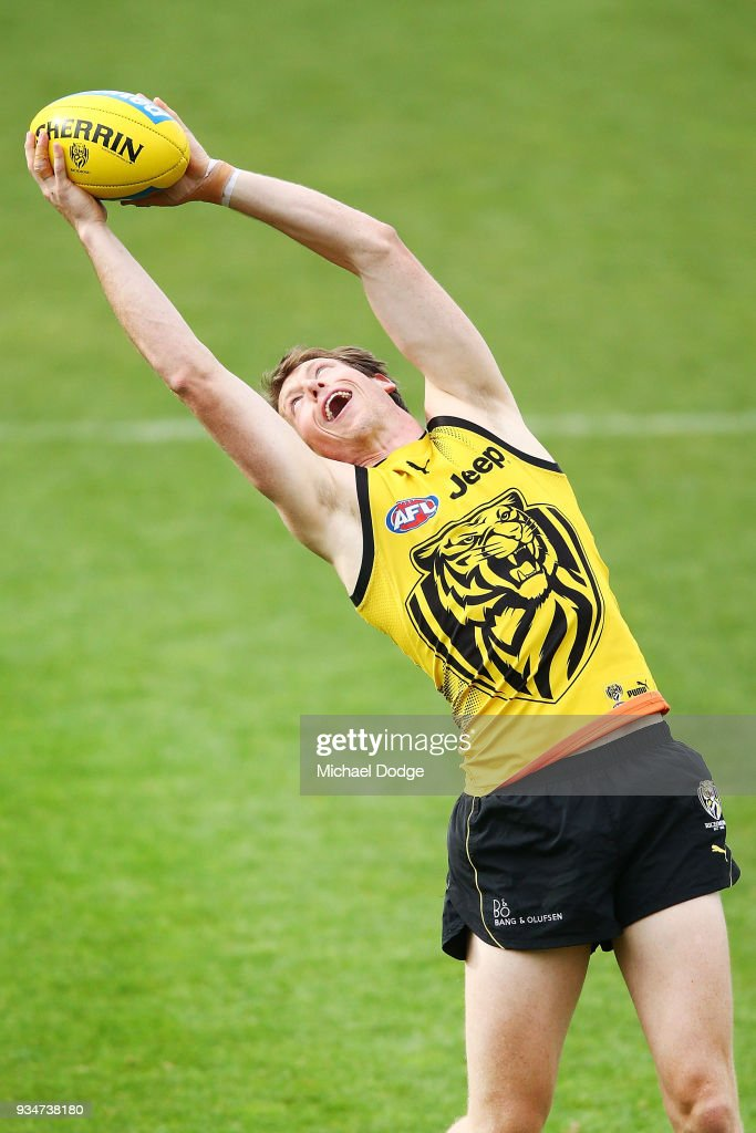 Dylan Grimes of the Tigers marks the ball during a Richmond Tigers AFL training session at Punt Road Oval on March 20, 2018 in Melbourne, Australia.