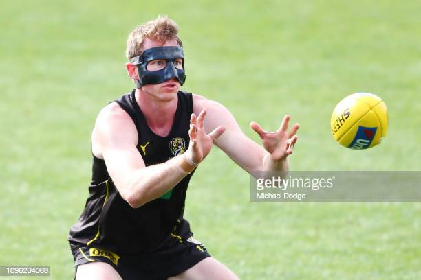Dylan Grimes of the Tigers wears a protective face mask during a Richmond Tigers AFL training session at Punt Road Oval on January 18 2019 in...