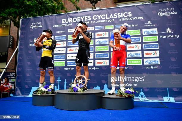 Dylan Groenewegen of Norway Elia Viviani of Italy and Arnaud Demare of France celebrate the EUROEYES CYCLASSICS Hamburg race on August 20 2017 in...