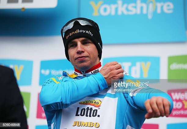 Dylan Groenewegen of Team Lotto NLJumbo and the Netherlands puts on his jersey after winning the first stage of the 2016 Tour de Yorkshire from...